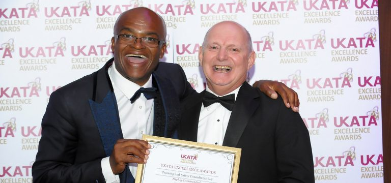 TASC UKATA award win with Chris Akabusi